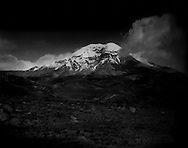 "Chimborazo Volcano, the furthest point from the center of the earth (because of the earth's equatorial bulge) rises above the high, sandy ""el arenal"" semi-desert.  Chimborazo is the highest mountain in Ecuador (6,268 metres [20,564 ft])."