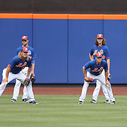 NEW YORK, NEW YORK - June 21: Waiting to field fly balls at batting practice are Noah Syndergaard #34, (left) and Steven Matz #32 of the New York Mets  before the Kansas City Royals Vs New York Mets regular season MLB game at Citi Field on June 21, 2016 in New York City. (Photo by Tim Clayton/Corbis via Getty Images)