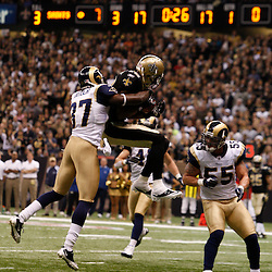 December 12, 2010; New Orleans, LA, USA; New Orleans Saints wide receiver Marques Colston (12) catches a touchdown over St. Louis Rams cornerback Quincy Butler (36) during the first quarter at the Louisiana Superdome. Mandatory Credit: Derick E. Hingle-US PRESSWIRE