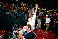 "ST. LOUIS, MO-SEPTEMBER 8:   Mark McGwire #25 of the St. Louis Cardinals waves to the fans from a special 1962 Corvette post game after hitting his 62nd home run of the season, breaking the single season home run record held by Roger Maris in 1961, on September 8, 1998 at Busch Stadium in St. Louis, Missouri.  The summer of 1998 what has been called the ""Great Home Run Race of 1998"".  McGwire and Sammy Sosa were both attempting to break the single season home run record of 61 held by Roger Maris since 1961.(Photo by Ron Vesely)"