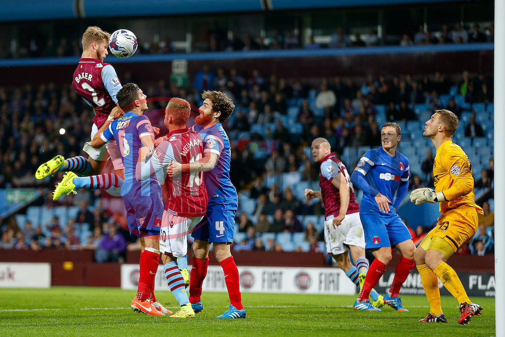 Nathan Baker of Aston Villa heads a cross wide past the post of Gary Woods of Leyton Orient - Photo mandatory by-line: Rogan Thomson/JMP - 07966 386802 - 27/08/2014 - SPORT - FOOTBALL - Villa Park, Birmingham - Aston Villa v Leyton Orient - Capital One Cup Round 2.