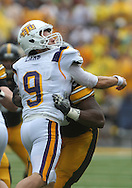 September 3, 2011: Tennessee Tech Golden Eagles quarterback Tre Lamb (9) is hit by Iowa Hawkeyes defensive lineman Mike Daniels (93) during the first half of the game between the Tennessee Tech Golden Eagles and the Iowa Hawkeyes at Kinnick Stadium in Iowa City, Iowa on Saturday, September 3, 2011. Iowa defeated Tennessee Tech 34-7 in a game stopped at one point due to lightning and rain.