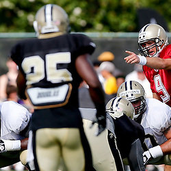 Aug 3, 2013; Metairie, LA, USA; New Orleans Saints quarterback Drew Brees (9) at the line during a scrimmage at the team training facility. Mandatory Credit: Derick E. Hingle-USA TODAY Sports