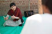 Tinni Sawhney, CEO of Aga Khan Foundation, talking to farmers on a farm in Indore, India
