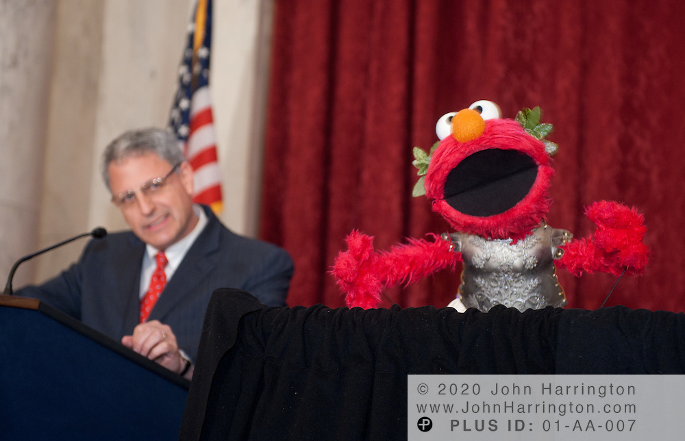 "Sesame Workshop President and CEO Gary E. Knell speaks, alongside Sesame Street character Elmo, at a press conference announcing a new partnership between The National Children's Museum and the Sesame Workshop at the Russell Senate Office Building in Washington, DC on February 3, 2011.  The Sesame Workshop, the organization behind the television show ""Sesame Street"" will have a permanent home in the nation's capital, a move that will expand the organization's mission of education."