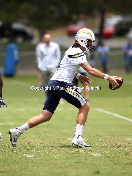 San Diego Chargers quarterback Zach Mettenberger (4) hands off the ball on a running play during the Chargers 2016 NFL minicamp football practice held on Tuesday, June 14, 2016 in San Diego. (©Paul Anthony Spinelli)