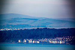 Looking towards Dalgetpty Bay and the Ochil Hills, past the River Forth, from West Shore Road, Edinburgh.