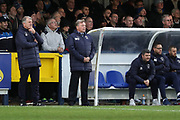 AFC Wimbledon manager Wally Downes, AFC Wimbledon first team coach Glyn Hodges and AFC Wimbledon coach Simon Bassey watching from the sidelines during the EFL Sky Bet League 1 match between AFC Wimbledon and Rochdale at the Cherry Red Records Stadium, Kingston, England on 8 December 2018.