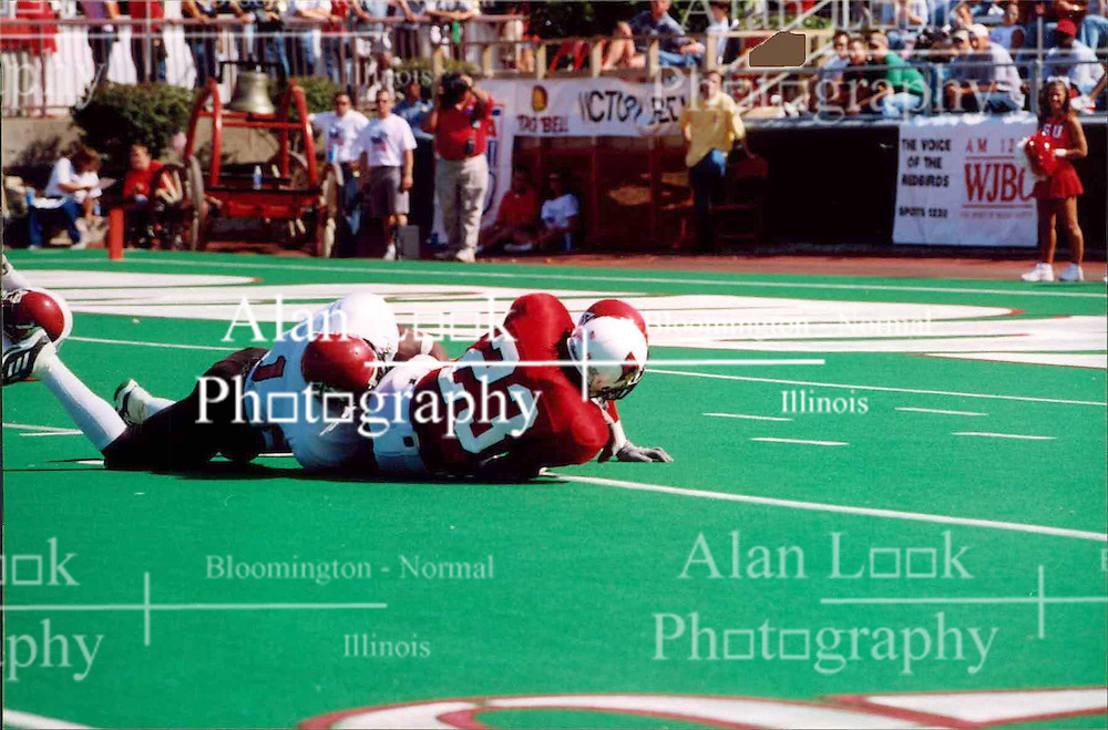 September 22, 2001:  Illinois State Redbirds Football, Willie Watts gets tackled by Leotis Belcher..This image was scanned from a print.  Image quality may vary.  Dust and other unwanted artifacts may exist.