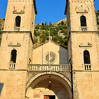 St. Tryphon Cathedral in Kotor, Montenegro<br /> St. Tryphon Cathedral is one of Kotor's most recognizable landmarks. This Roman Catholic church was built in 1166 on the site of a previous one from 809. Both were dedicated to Saint Tryphon, a 3rd century martyr and the protector of the city. Despite being partially destroyed during an earthquake in 1667 and again in 1979, the imposing western façade of Katedrala Svetog Tripuna was faithfully restored in 2009. Its Korčula stone glows with a golden hue just before sunset.