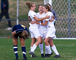 Virginia Cavaliers midfielder/defender Nikki Krzysik (23), Virginia Cavaliers midfielder/defender Alli Fries (8) and Virginia Cavaliers midfielder/forward Sinead Farrelly (17) celebrate UVA's victory over WVU in front of West Virginia Mountaineers forward Blake Miller (3).  The #16 ranked Virginia Cavaliers defeated the #12 ranked West Virginia Mountaineers 3-2 in the second round of NCAA Division 1 Women's Soccer Tournament at Klockner Stadium on the Grounds of the University of Virginia in Charlottesville, VA on November 16, 2008.