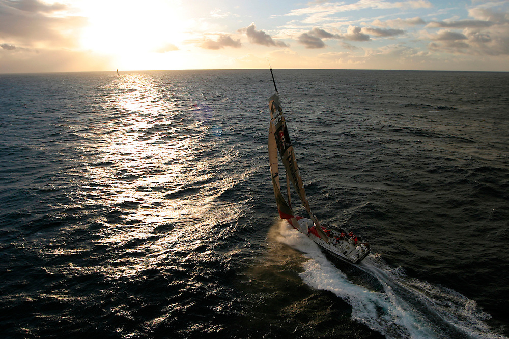 """Volvo Ocean Race 2005-2006. Leg 1 start, 12th November 2005 - Vigo, Galicia, Spain. Next stop - 6,400 nautical miles to Capetown, South Africa..Start time 14h00 local time. 50 nautical miles offshore 4 hours after the start..American entry """"Pirates of The Caribbean/The Black Pearl"""", sponsored by Disney and skippered by Paul Cayard (USA) chase down Swedish entry """"Ericsson Racing Team"""", skippered by Neal McDonald (UK)."""