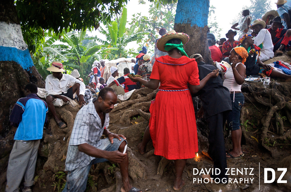 Voodooists worship the lwas - voodoo spirits - at the base of several trees on the edge of Ville Bonheur, Haiti during the Saut D'eau voodoo festival on July 16, 2008. The 3-day festival draws voodoo practitioners and Catholics to the small, remote village each July. Different lwas are often associated with different trees.