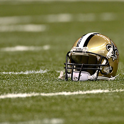 January 1, 2012; New Orleans, LA, USA; A detailed view of the helmet of New Orleans Saints quarterback Drew Brees on the fieldagainst the Carolina Panthers prior to kickoff of a game at the Mercedes-Benz Superdome. Mandatory Credit: Derick E. Hingle-US PRESSWIRE