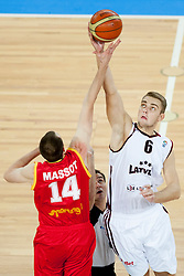 Sacha Massot #14 of Belgium and Rolands Freimanis #6 of Latvia jumping for the first ball in the game during basketball match between National teams of Latvia and Belgium in 2nd Round at Day 12 of Eurobasket 2013 on September 14, 2013 in SRC Stozice, Ljubljana, Slovenia. (Photo By Urban Urbanc / Sportida)