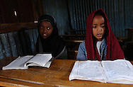 Dessie, Ethiopia: Children learning to read the Koran in Arabic at the Showber Islamic School in northern Ethiopia. Many students have their tuition paid by local townspeople, or outsiders, such as a Saudi Arabian businessman who is currently funding much of the school's budget. (PHOTO: MIGUEL JUAREZ LUGO).