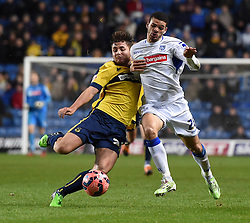 Oxford United's Joe Riley tackles Tranmere Rovers' Shamir Fenelon - Photo mandatory by-line: Paul Knight/JMP - Mobile: 07966 386802 - 06/12/2014 - SPORT - Football - Oxford - Kassam Stadium - Oxford United v Tranmere Rovers - FA Cup Second Round