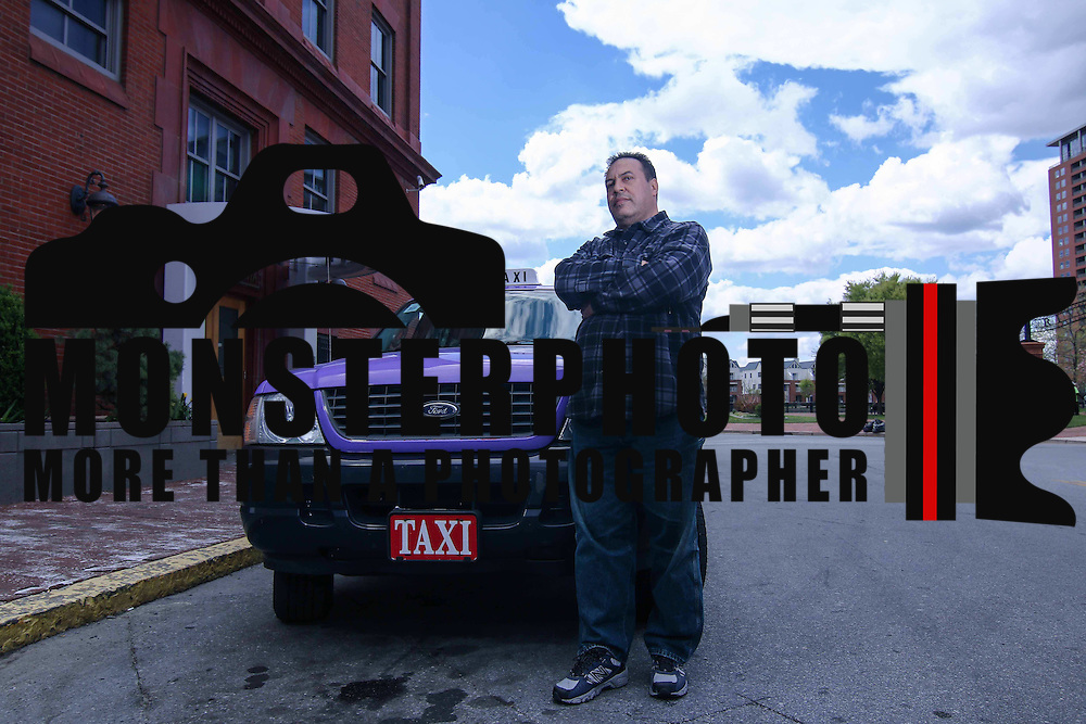 Abdellah Adlani of Universal Taxi service pose for a photo Monday, April 27, 2015, at Wilmington train station in downtown Wilmington Delaware.<br /> <br /> Delaware&rsquo;s taxi cab companies are up in arms, saying that Uber, the app-powered ride sharing service, is operating illegally in Wilmington and Newark.