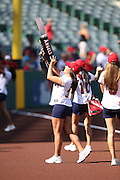 ANAHEIM, CA - AUGUST 21:  The Los Angeles Angels of Anaheim Strike Force shoots baseball like shirts to fans before the game against the Cleveland Indians on Wednesday, August 21, 2013 at Angel Stadium in Anaheim, California. The Indians won the game 3-1. (Photo by Paul Spinelli/MLB Photos via Getty Images)