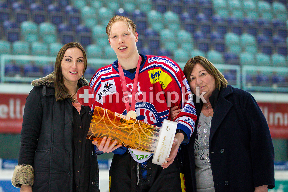 Rapperswil-Jona Lakers forward Ryhor Ustsimenka poses for a photo with his gold medal and the Swiss Champion trophy after winning the fifth Elite B Playoff Final ice hockey game between Rapperswil-Jona Lakers and ZSC Lions held at the SGKB Arena in Rapperswil, Switzerland, Sunday, Mar. 19, 2017. (Photo by Patrick B. Kraemer / MAGICPBK)