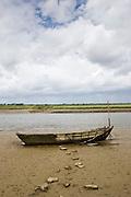 Old wrecked fishing boat in Les Marais de la Douve, the Marais marshland area of Normandy, France
