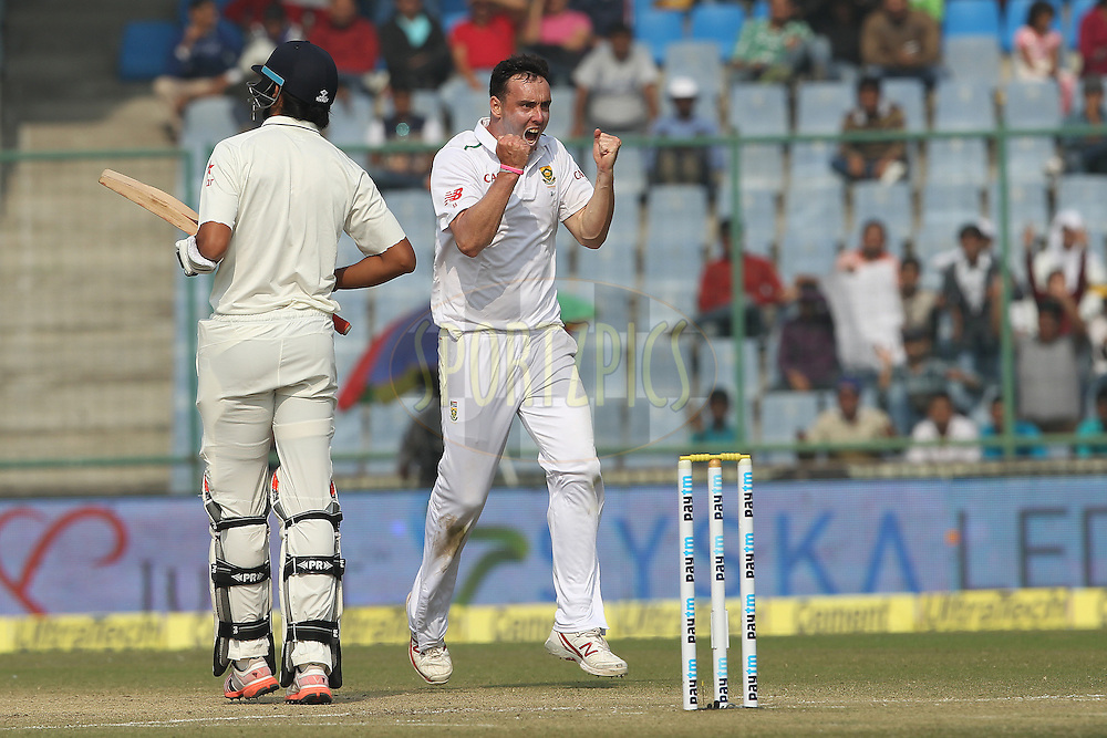 Kyle Abbott of South Africa celebrates the wicket of  Ishant Sharma of India and ending the Indian innings during day two of the 4th Paytm Freedom Trophy Series Test Match between India and South Africa held at the Feroz Shah Kotla Stadium in Delhi, India on the 4th December 2015<br /> <br /> Photo by Ron Gaunt  / BCCI / SPORTZPICS