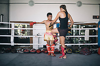 Thays Runge, a German traveler, sparring with her trainer at the Chiangmai Muay Thai Training Center in northern Thailand.