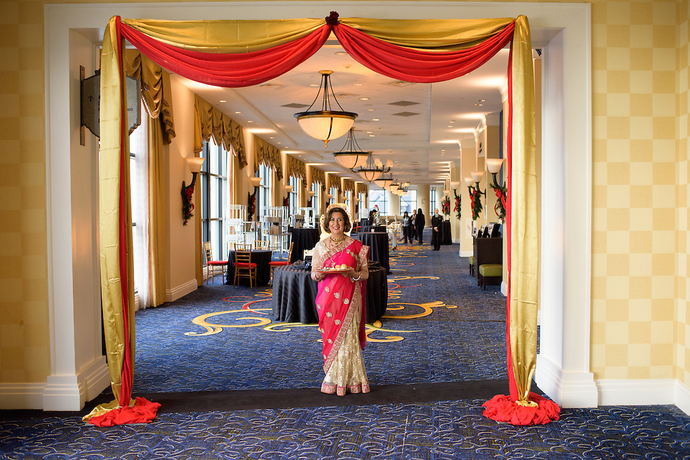 Baltimore, Maryland - December 20, 2014: Mother of the bride Reena Pasricha waits for the barati, or groom's procession party, to arrive. She then perform the Dwar Puja, a traditional Indian welcome ritual, with her future son-in-law Eshwan Ramudu. <br /> <br /> Trisha Satya Pasricha and Eshwan Ramudu married at the Baltimore Marriott Waterfront Hotel December 20, 2014. <br /> <br /> <br /> CREDIT: Matt Roth for The New York Times<br /> Assignment ID: 30168620A