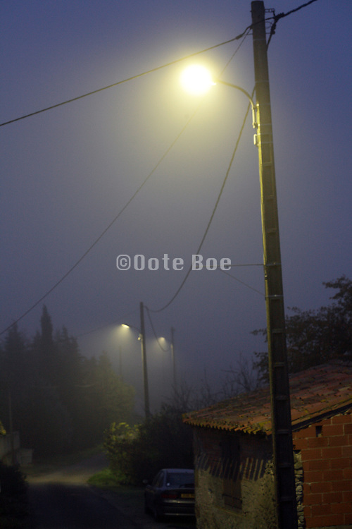 streetlights with a light fog