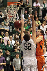 01 March 2014:  Peter Smith slips the ball past Mike Marietti during an NCAA mens division 3 CCIW  Championship basketball game between the Wheaton Thunder and the Illinois Wesleyan Titans in Shirk Center, Bloomington IL