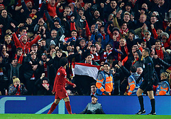 LIVERPOOL, ENGLAND - Tuesday, December 11, 2018: Liverpool's Mohamed Salah celebrates scoring the first goal as a supporter holds up an Egypt flag during the UEFA Champions League Group C match between Liverpool FC and SSC Napoli at Anfield. (Pic by David Rawcliffe/Propaganda)