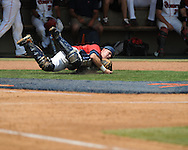 Mississippi's Miles Hamblin (24) catches a foul ball vs. St. John's during an NCAA Regional game at Davenport Field in Charlottesville, Va. on Sunday, June 6, 2010.
