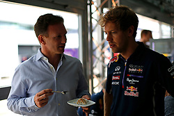 03.07.2014, Silverstone Circuit, Silverstone, ENG, FIA, Formel 1, Grand Prix von Grossbritannien, Vorberichte, im Bild Christian Horner (GBR) Red Bull Racing Team Principal and Sebastian Vettel (GER) Red Bull Racing // during the preperation of British Formula One Grand Prix at the Silverstone Circuit in Silverstone, Great Britain on 2014/07/03. EXPA Pictures © 2014, PhotoCredit: EXPA/ Sutton Images/ Martini<br /> <br /> *****ATTENTION - for AUT, SLO, CRO, SRB, BIH, MAZ only*****