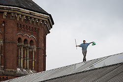 © Licensed to London News Pictures . 15/09/2015 . Manchester , UK . STUART HORNER on the roof at HMP Manchester (formerly Strangeways Prison ), this morning (15th September 2015) . Photo credit : Joel Goodman/LNP