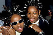 Two girls with braids and jewellery, Notting Hill Carnival, UK, 2000's