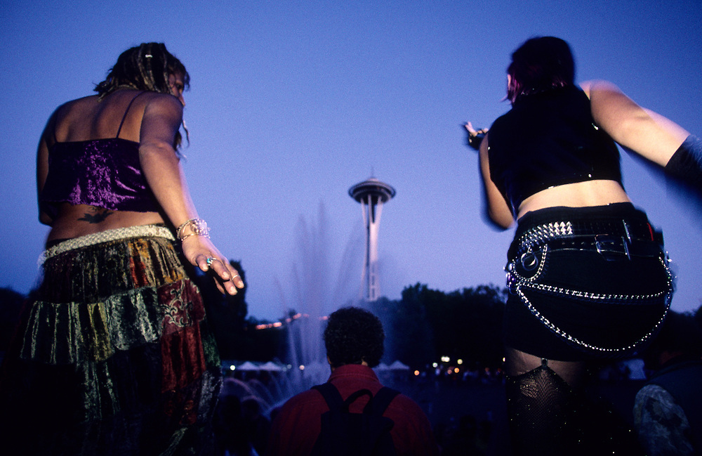 United States, Washington State, Seattle. Dancers and Space Needle at the annual Bumbershoot Festival.