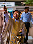 27 MARCH 2016 - BANGKOK, THAILAND:  The priest sprinkles holy water on parishioners during Easter services at Santa Cruz Church in Bangkok. Santa Cruz was one of the first Catholic churches established in Bangkok. It was built in the late 1700s by Portuguese soldiers allied with King Taksin the Great in his battles against the Burmese who invaded Thailand (then Siam). There are about 300,000 Catholics in Thailand, in 10 dioceses with 436 parishes. Easter marks the resurrection of Jesus after his crucifixion and is celebrated in Christian communities around the world.     PHOTO BY JACK KURTZ