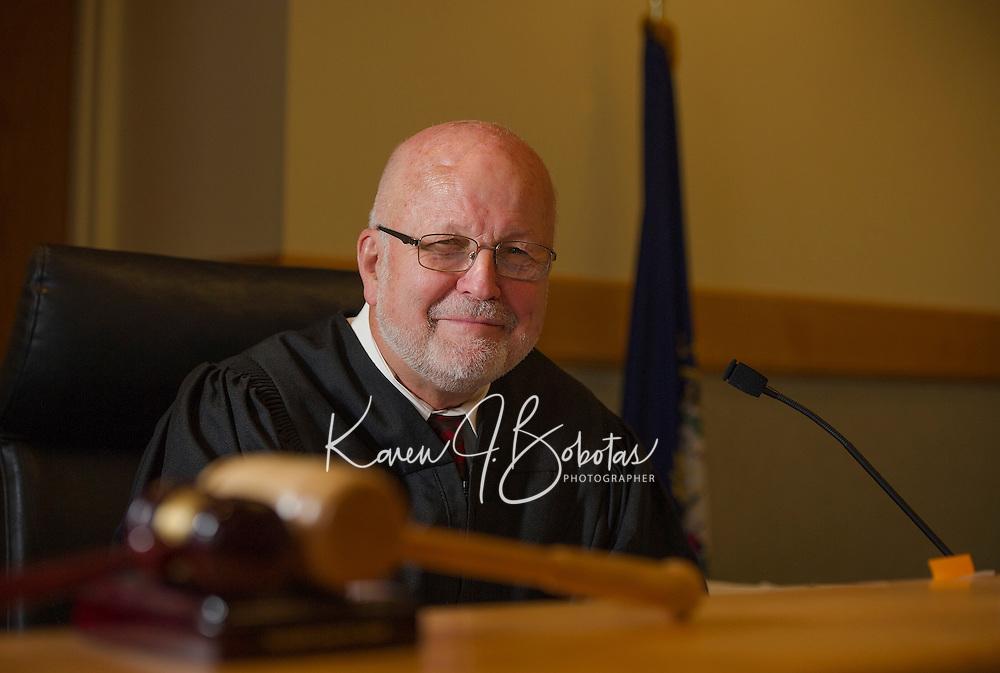 Judge James Carroll sits at his bench in Laconia District Court.  (Karen Bobotas/Photographer)