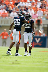 Virginia cornerback Chris Cook (26) congratulates Virginia safety Byron Glaspy (22) after breaking up a GT pass play.  The Virginia Cavaliers football team faced the Georgia Tech Yellow Jackets at Scott Stadium in Charlottesville, VA on September 22, 2007.