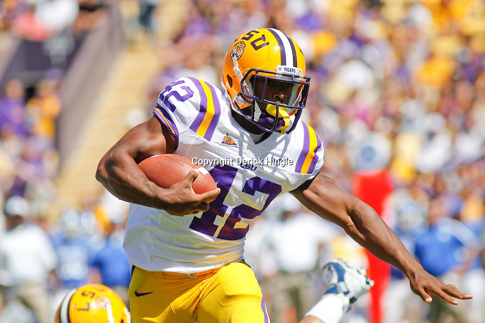 October 1, 2011; Baton Rouge, LA, USA;  LSU Tigers running back Michael Ford (42) against the Kentucky Wildcats during the third quarter at Tiger Stadium. LSU defeated Kentucky 35-7. Mandatory Credit: Derick E. Hingle-US PRESSWIRE / © Derick E. Hingle 2011