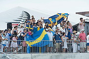 America's Cup Village, Bermuda. 10th June 2017. Artemis Racing (SWE) supporters cheer for the team as they leave the dock on day one of the Louis Vuitton America's Cup Challenger playoff finals against Emirates Team New Zealan