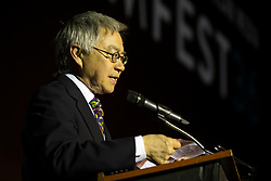"""Executive Director Stephen Gong of the Center for Asian American Media speak at the CAAM Film Festival's opening night film """"An American Story: Norman Mineta and His Legacy"""" at the Castro Theatre, Thursday, May 10, 2018 in San Francisco, Calif. (D. Ross Cameron/SF Chronicle)"""