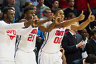 DALLAS, TX - FEBRUARY 19: (L to R) Jean-Micheal Mudiay #24, Ben Emelogu #21 and Ben Moore #00 of the SMU Mustangs give thumbs up during the closing minutes against the Temple Owls on February 19, 2015 at Moody Coliseum in Dallas, Texas.  (Photo by Cooper Neill/Getty Images) *** Local Caption *** Jean-Micheal Mudiay; Ben Emelogu; Ben Moore