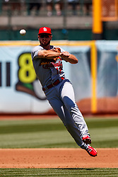OAKLAND, CA - AUGUST 04:  Paul DeJong #12 of the St. Louis Cardinals throws to first base against the Oakland Athletics during the second inning at the RingCentral Coliseum on August 4, 2019 in Oakland, California. The Oakland Athletics defeated the St. Louis Cardinals 4-2. (Photo by Jason O. Watson/Getty Images) *** Local Caption *** Paul DeJong