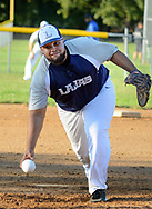Lamas pitcher Jerome Clavell makes a pitch during a semifinal playoff softball game against Real ponce in a league consisting of teams named after Puerto Rican cities Thursday, September 07, 2017 in Bristol, Pennsylvania. The teams in the league are named after various towns and areas in Puerto Rico, including Lajas, Real Ponce, Adjuntas and Comerio. (Photo by William Thomas Cain)
