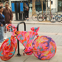 "A couple look at ""Bike-like object no. 9"" by Polish artist Olek at the Third Street Promenade on Friday, October 15, 2010."