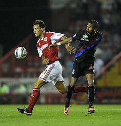 Bristol City's Marlon Pack heads the ball over Crystal Palace's Elliot Grandin - Photo mandatory by-line: Joe Meredith/JMP - Tel: Mobile: 07966 386802 27/08/2013 - SPORT - FOOTBALL - Ashton Gate - Bristol - Bristol City V Crystal Palace -  Capital One Cup - Round 2