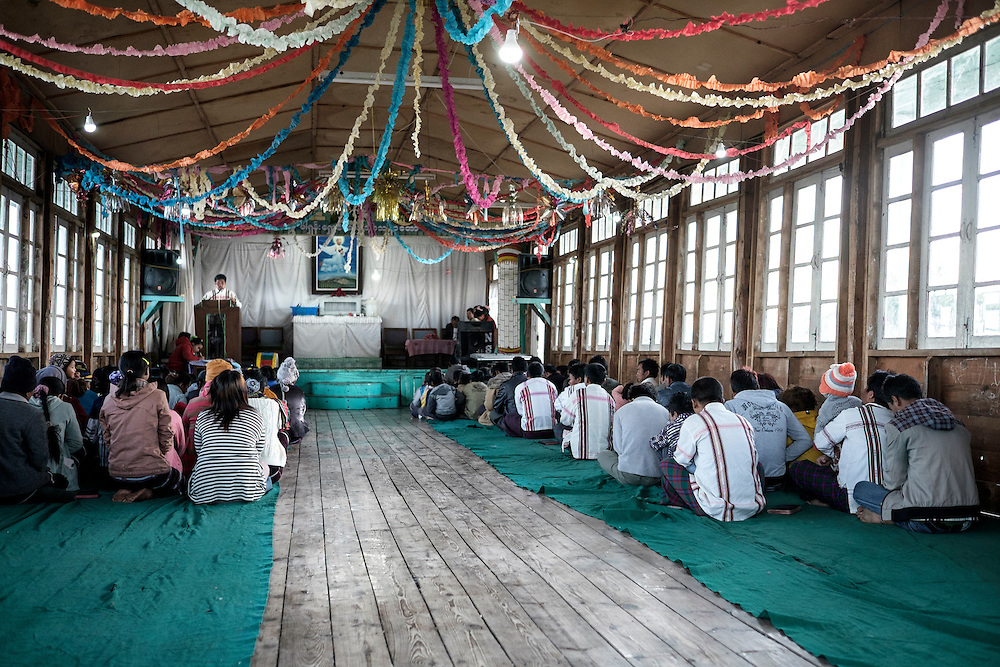 A group of followers of Siangsawn religious sect attend to a mass service in Tedim village.<br /> They believe in a supreme God called Pasian and a prophet called Pa Kam Suan Mang who is alive and lead the cult from a Siangswan village in Tedim township.