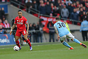 Liverpool defender Nathaniel Clyne (2)  takes on Manchester City defender Nicolas Otamendi (30)  during the Capital One Cup match between Liverpool and Manchester City at Anfield, Liverpool, England on 28 February 2016. Photo by Simon Davies.