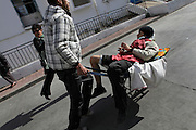 A protester injured during a clash with the police is carried to the hospital.Tunisians from province camp under the the Prime Minister's office demanding the dissolution of the interim governement.